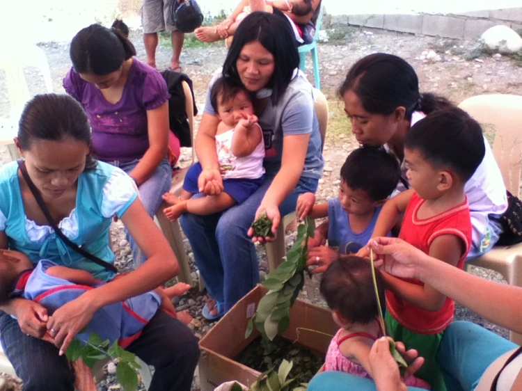 Mothers learning how to make their own organic pesticides.