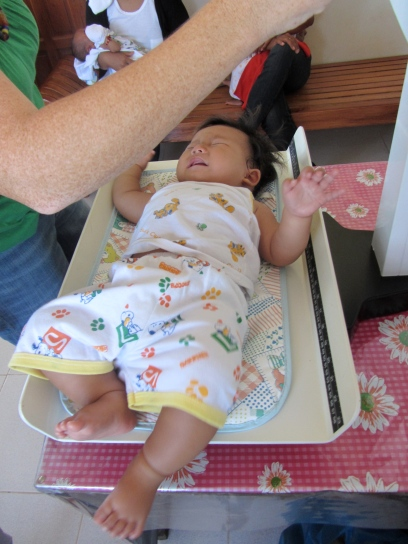 Monthly weighing of babies at the Well-Baby Seminar