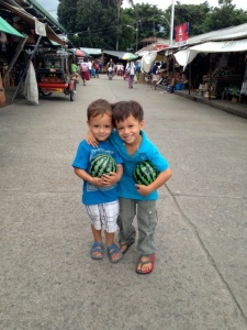 Zion and Lucas at the market.