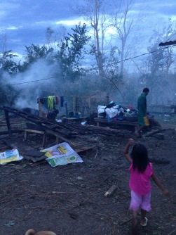 A family tries to clean up after the destruction.